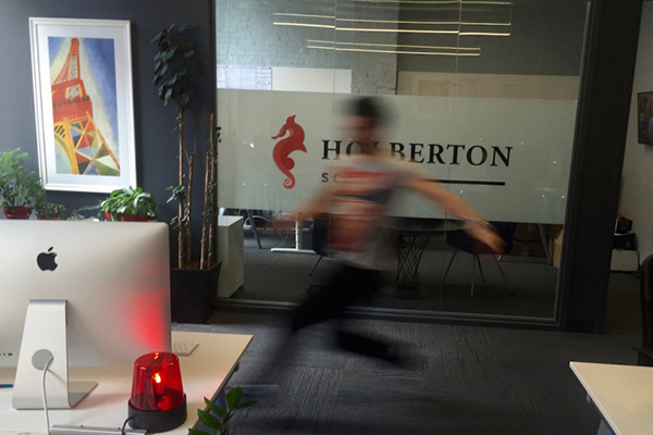 Software Engineer running toward a computer